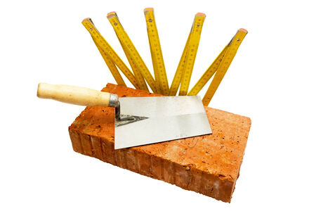 reconstruct: Set of masonry tool including brick trowel and meter isolated on white