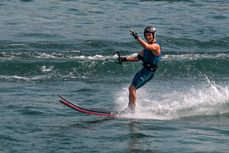 Geneva, Switzerland, August 1st, 2013 - Water skier skiing on lake and waves hello to me