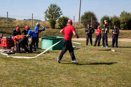 TESANY, CZECH REPUBLIC - Circa September, 2013 - Voluntary fire fighters training during sunny day
