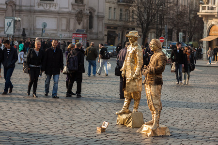 PRAGUE, CZECH REPUBLIC - MARCH 8th, 2014 - Live statues street artists perform on Old Town Square