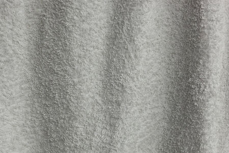 Texture of the waving white towel closeup