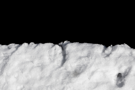 Pile of snow isolated on black background