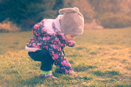 girl scout: Little baby toddler exploring cold outside world in the evening