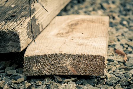 balk: Aged wooden planks on stones in shallow depth of field