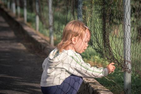 Little sad girl in poor city Stok Fotoğraf