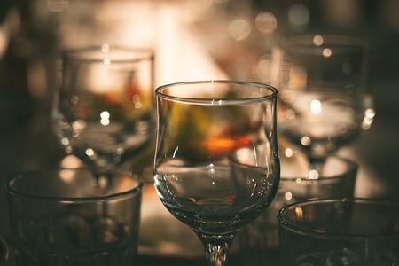 Empty wine glasses on dinner table in restaurant Stok Fotoğraf