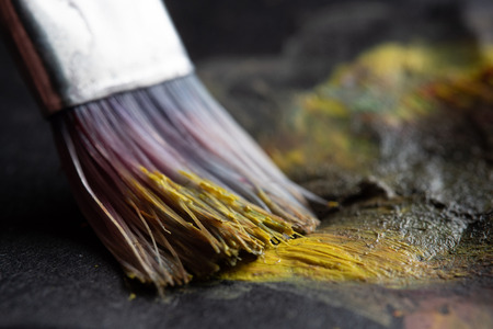 Paintbrush mixing colors extreme macro close-up shot 写真素材