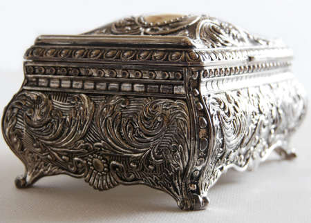 Silver ancient casket on white background