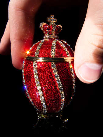 Faberge Egg In hands luxory photo
