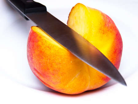 ripe peach knifed isolated white Stock Photo - 7998448