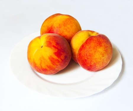 Three juicy peaches isolated white Stock Photo - 7998447