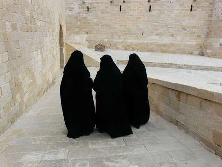 Three women in yashmak black Stock Photo