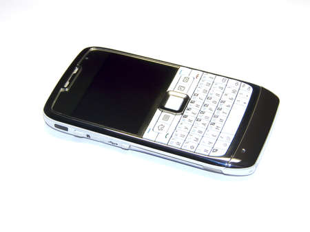 White mobile phone. Isolated in white Stock Photo - 7998446