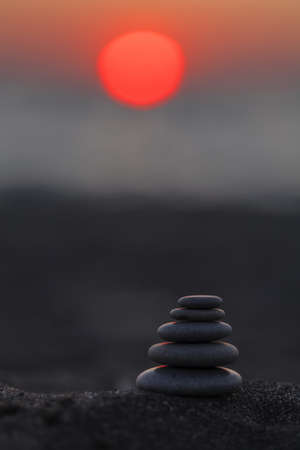 black stones: Zen stones at sunset by the sea