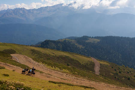 Horseback riding in the Caucasian mountains at Rosa Khutor 版權商用圖片