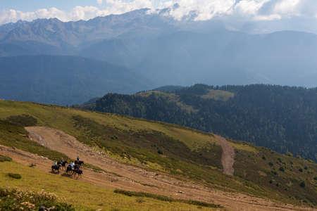 Horseback riding in the Caucasian mountains at Rosa Khutor 版權商用圖片 - 52588630