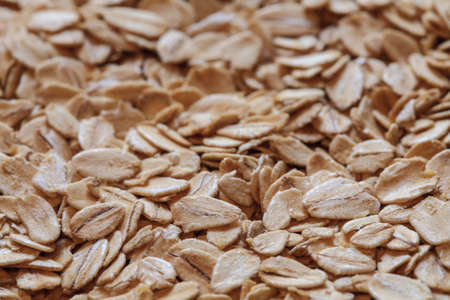 rolled oats: oatmeal grains photo, oat flakes, rolled oats, oat background. oatmeal photo, dry oatmeal Stock Photo
