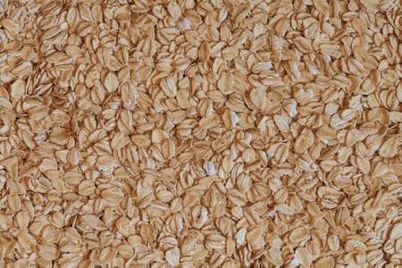 rolled oats: oat flakes photo, rolled oats, oat background. oatmeal photo, dry oatmeal, oatmeal grains
