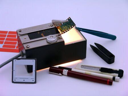 slideshow: Diaschneider and utensils for labeling Stock Photo