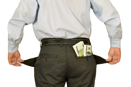 money man: men businessman showing empty pockets hiding behind wads of money Stock Photo