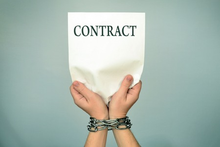 Man with bound hands to hold a contract.