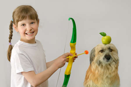 kid Archer plays with a dog in the sniper