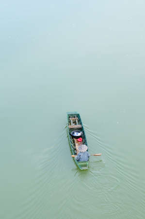 Rowing boat in the water photo