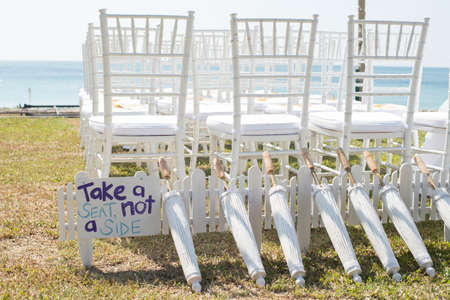 wedding chairs: white wedding chair on the beach Stock Photo
