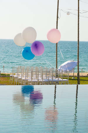 whie: wedding setting with reflection in the pool Stock Photo