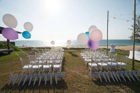 wedding setting on the beach with balloons Banco de Imagens