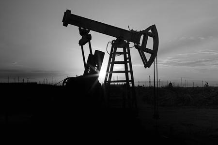 jack pump: Fossil Fuel Energy, Oil Pump, Pumpjack, Old Pumping Unit, Jack Pump, Sunset.Rows of oil donkey in silhouette at sunset crude oil. Stock Photo