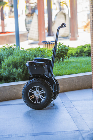 alternative transport: self-balancing electric scooter with two wheels. Off-road self-balancing scooter. Alternative transport. Stock Photo