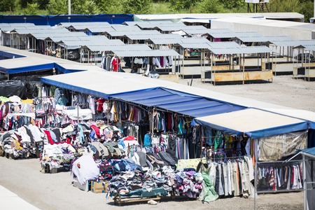 second hand: CHISINAU, MOLDOVA- Tourists and locals looking at the stalls at Chisinau flea market in Moldova. At the flea market one can find second hand clothes and shoes, souvenirs and paintings Stock Photo