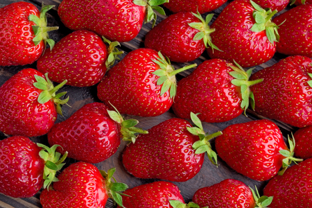 background from freshly harvested strawberries, directly above.