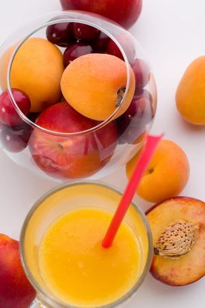 Glass of orange juice with fruit glass box isolated on white. Archivio Fotografico