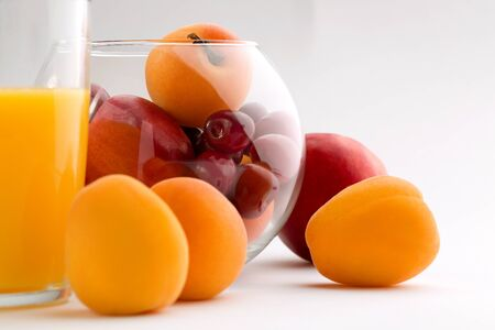 Glass of orange juice with fruit glass box isolated on white. 写真素材