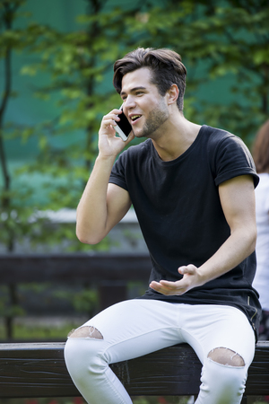 handsome happy man talking on the phone.