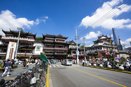 Chenghuangmiao street with travelers and pagoda style buildings. The City God Temple located in the bustling City Gods Temple Tourist Area, shot on October 14, 2016 in Shanghai, China.