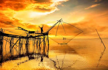 fishnets: Fisherman silhouette on fishnets