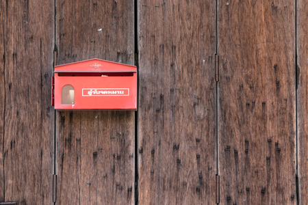 post box on the wooden door photo