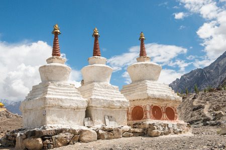lamaism: Tibetan White Pagodas with Blue Sky, Thiksey Monastery, in Leh - Ladakh, North of India Stock Photo
