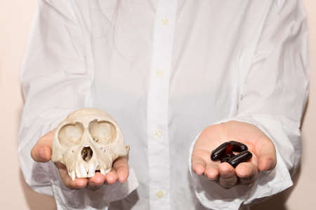 Weight loss pills and skull on women hand .suicide pills, drug can kill you