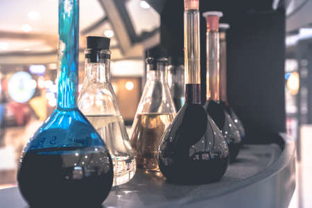 test glass: Pharmacy and chemistry theme. Test glass flask with solution in research laboratory. Shallow DOF. fade filter