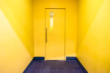 wooden color: Closed yellow  Door on Yellow Wall