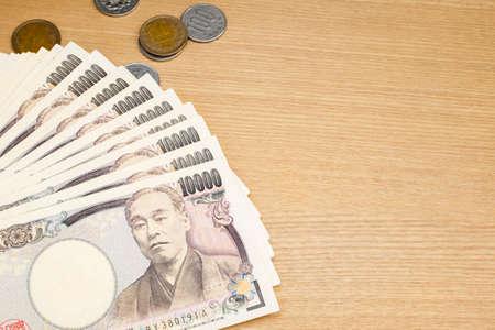 yen note: Japanese Yen on wood background