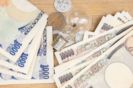 yen note: Concept of currency Japanese Yen and lamp for money idea