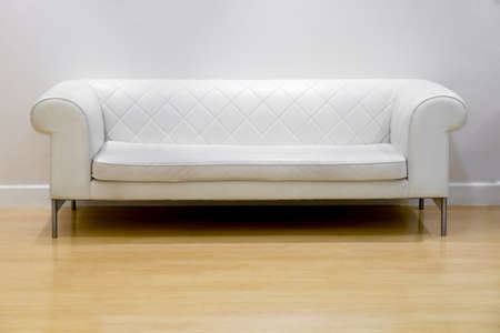 white wood floor: interior, leather sofa in white room and wood floor Stock Photo