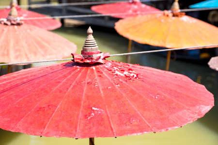 umbella: red and orange over thai water Stock Photo