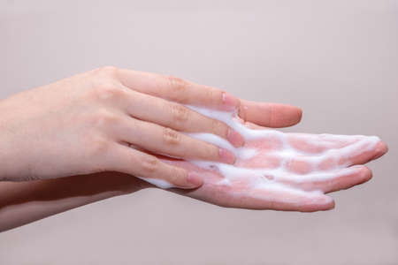 foaming: Women washing of hands with soap foam ,nice soft background