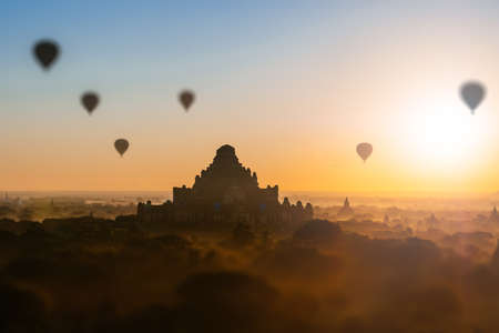 thousands: Scenic sunrise with many hot air balloons above Bagan in Myanmar. Bagan is an ancient city with thousands of historic buddhist temples and stupas.